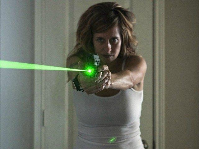 woman-with-gun-Melody-AP